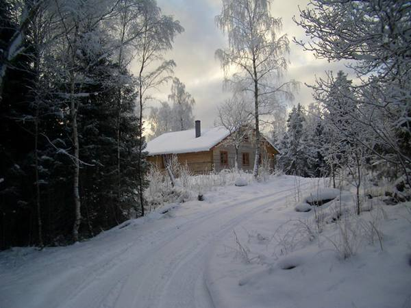Blockhaus Fuchsbau im winter in schweden
